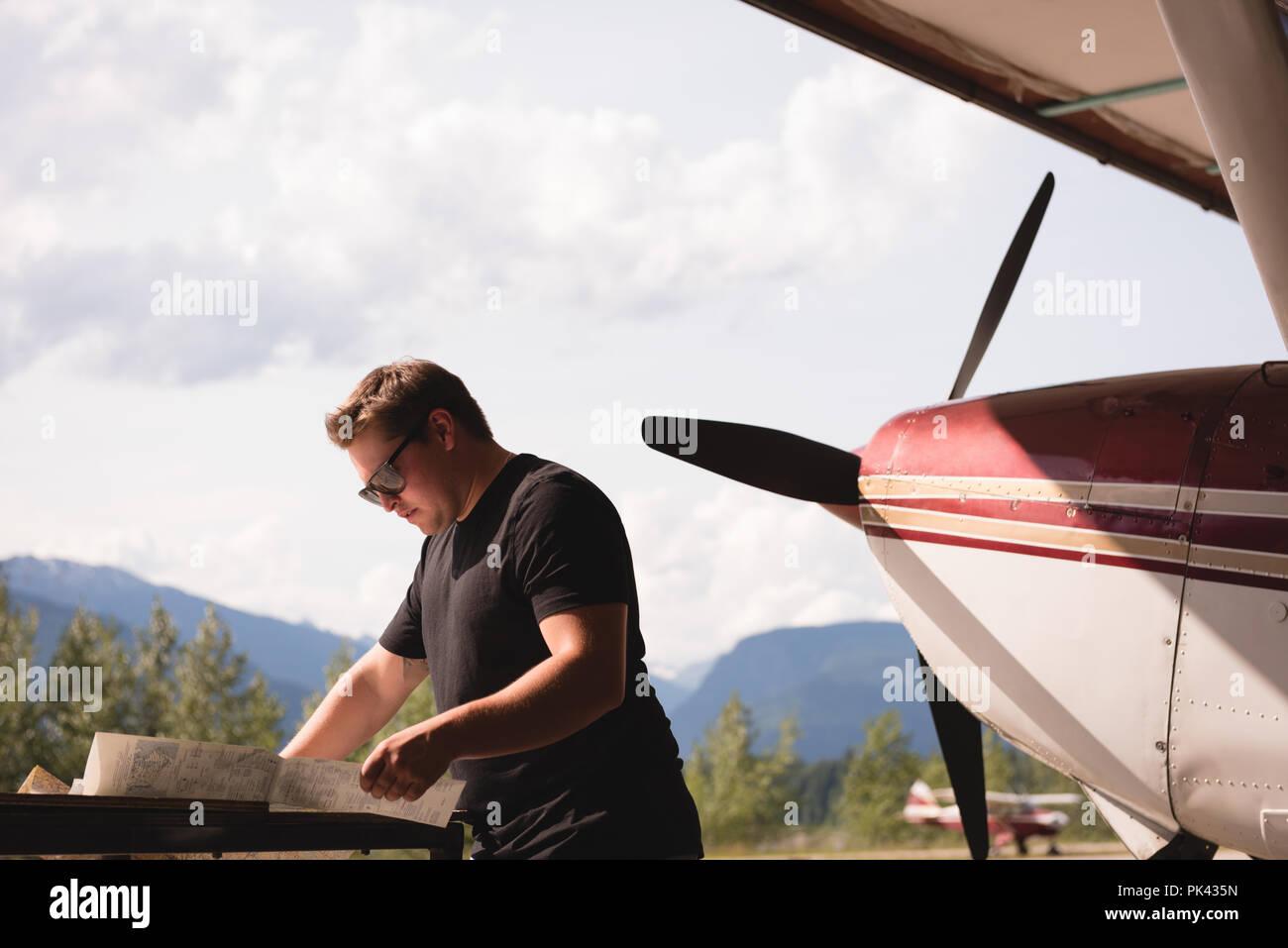 Mechanic working at aerospace hangar - Stock Image