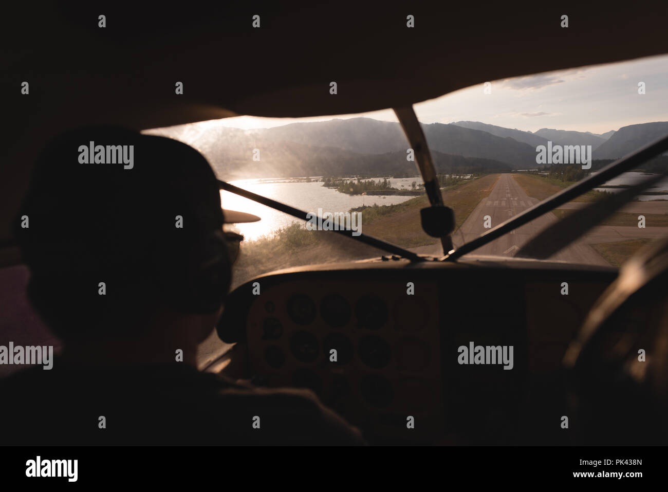 Pilot taking off aircraft on runway - Stock Image