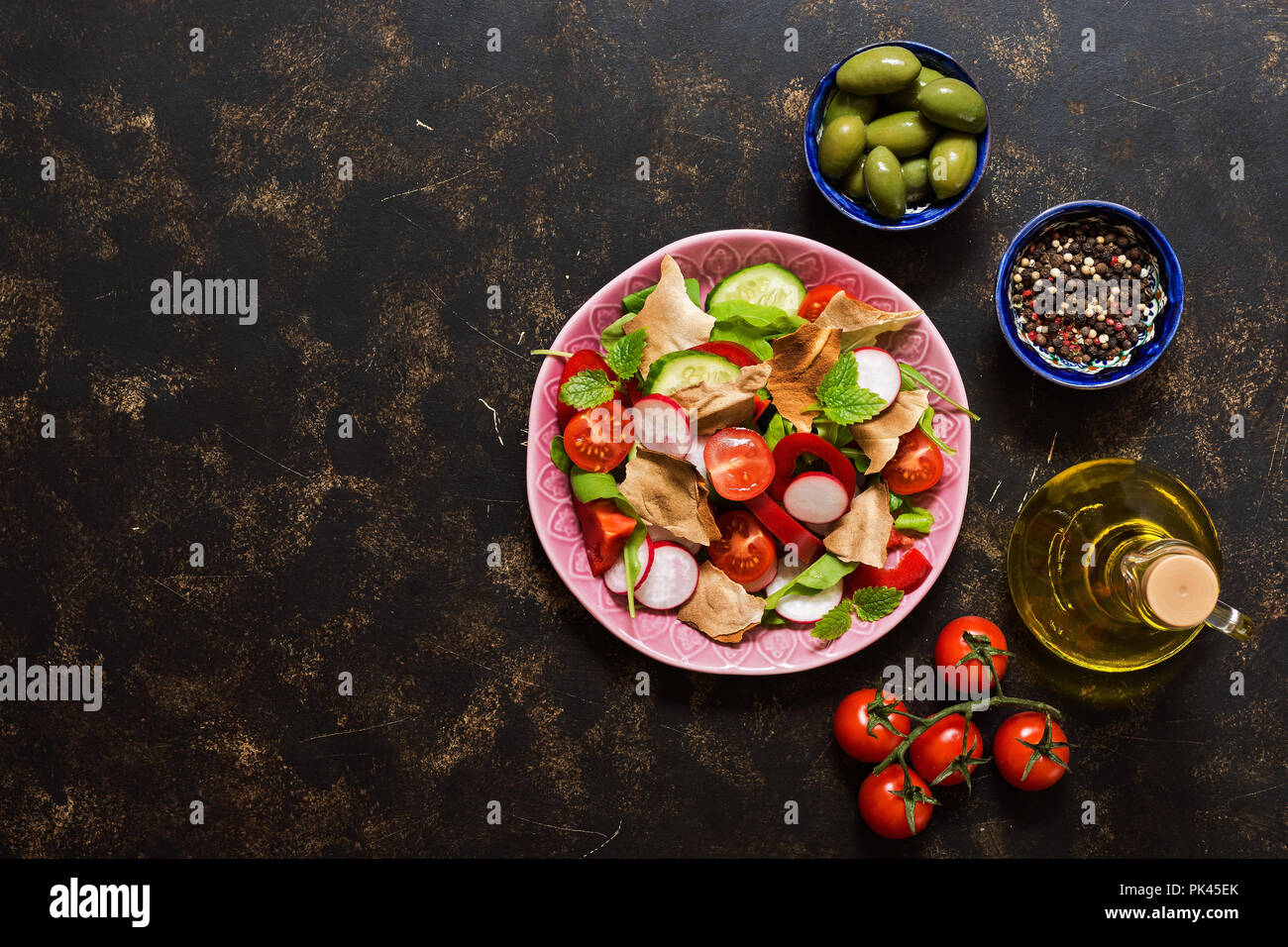 Fattoush Arabian salad. Brown background, top view, space for text - Stock Image