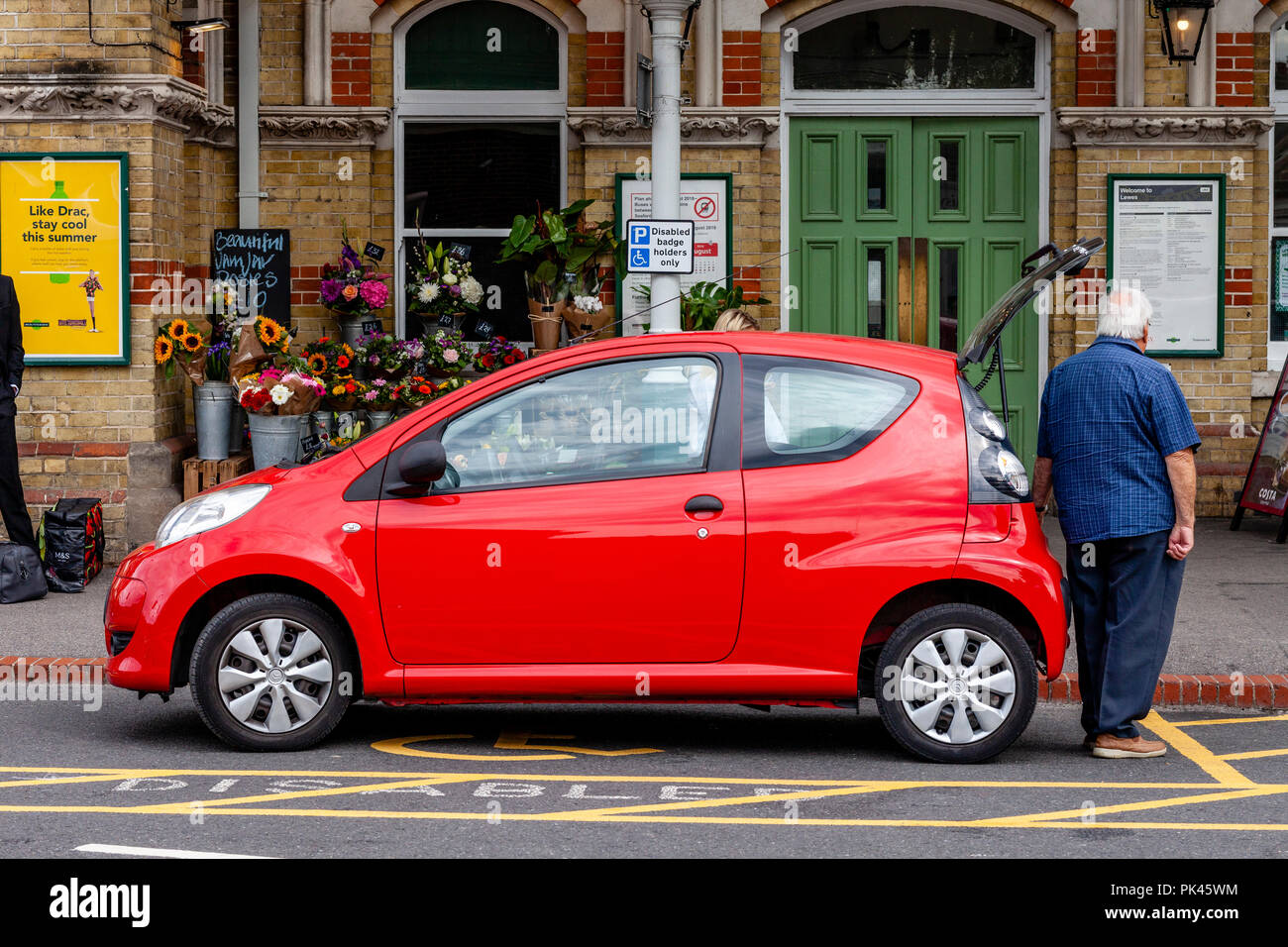 A Car Parked In A Disabled Bay, Lewes, East Sussex, UK - Stock Image