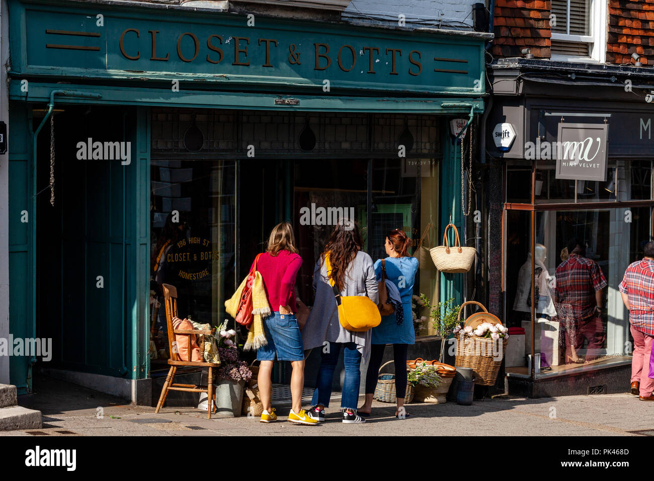 A Group Of Women Shopping At Closet and Botts Homeware Store, High Street, Lewes, East Sussex, UK - Stock Image