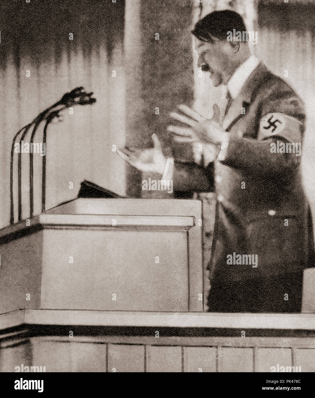 Adolph Hitler's speech at the Nuremberg rally, September 12, 1938 declaring that the oppression of Sudeten Germans must end.  Adolf Hitler,1889 – 1945. German politician, demagogue, Pan-German revolutionary, leader of the Nazi Party, Chancellor of Germany, and Führer of Nazi Germany from 1934 to 1945.  From These Tremendous Years, published 1938. - Stock Image