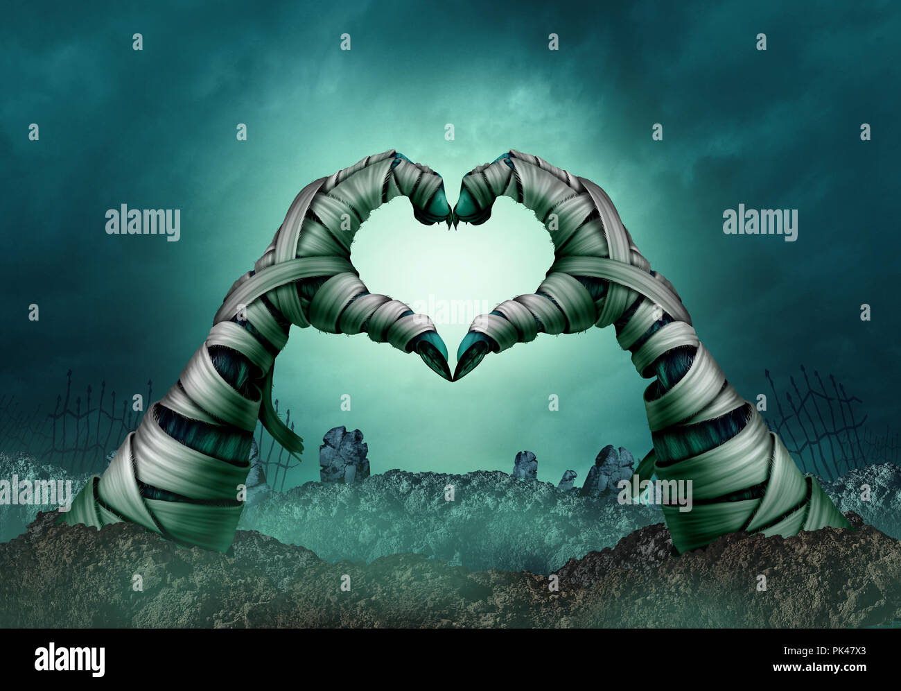 Mummy hand heart shape in a creepy night graveyard background as zombie halloween arms emerging from a cemetery grave or scary. - Stock Image