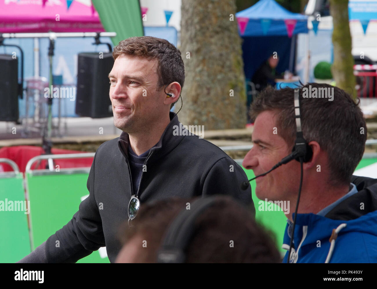 Stage 6 Tour of Britain 2018 7 September. Yanto Barker, presenter for ITV4, with film crew at Whinlatter preparing for live broadcast of race. - Stock Image