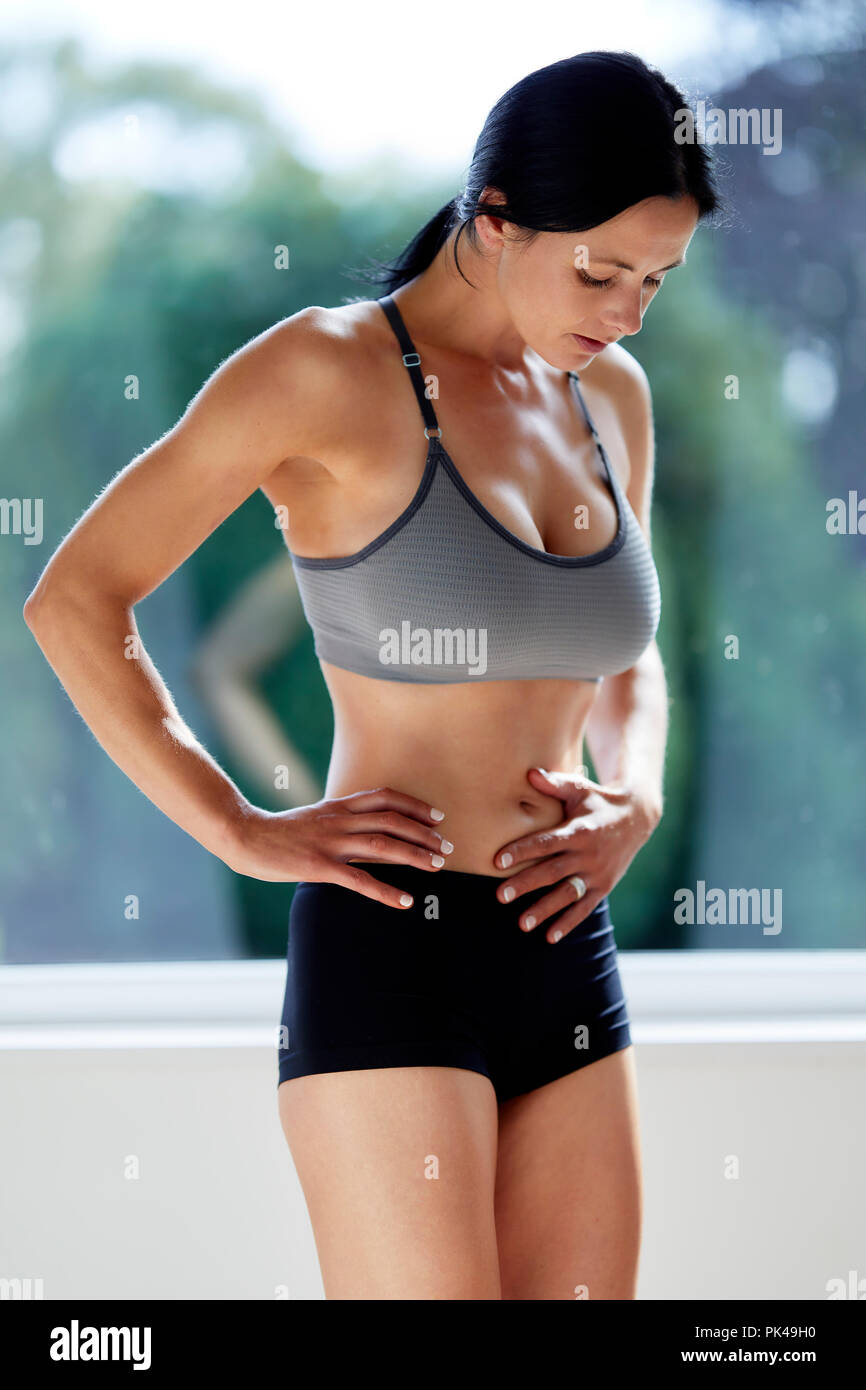 Girl cooling down after exercising - Stock Image