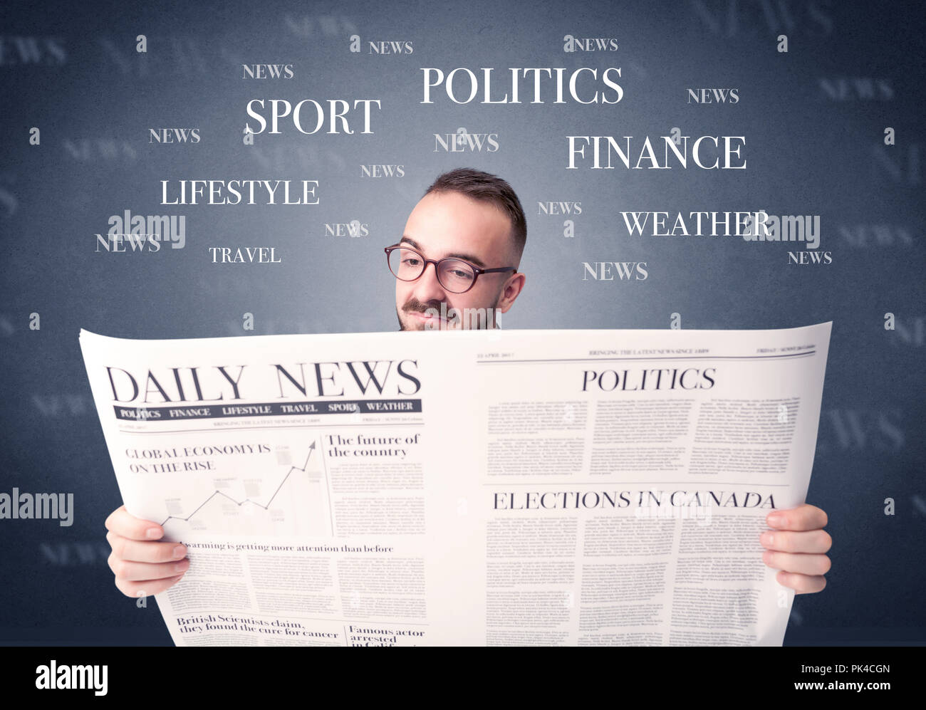 Young smart businessman reading daily newspaper - Stock Image