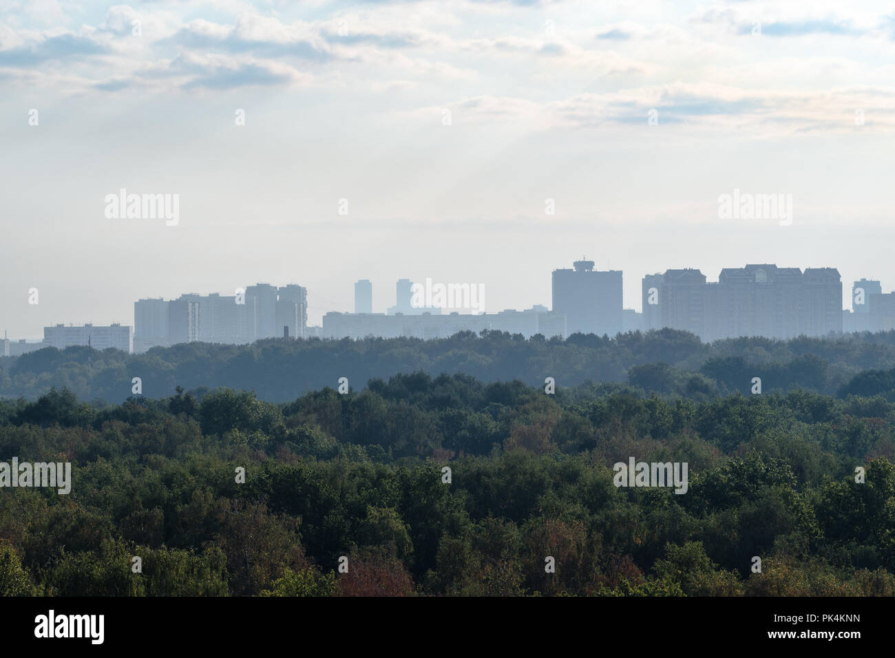 early blue dawning over urban park and apartment houses in Moscow city in September - Stock Image