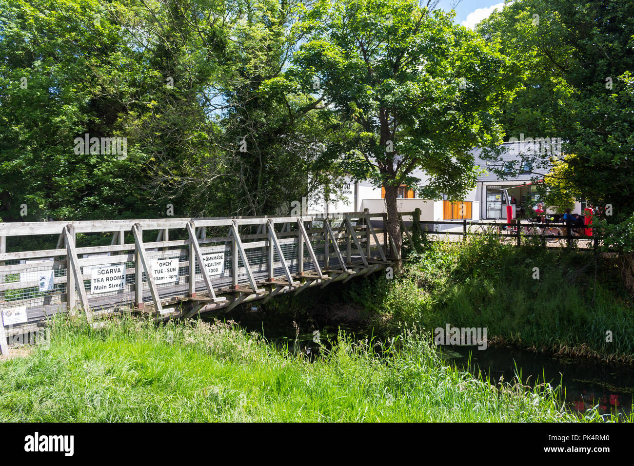 Wooden bridge across a disused canal linking the towpath to Scarva Tea Rooms and Scarva Visitor Centre. Scarva, County Down, N.Ireland. - Stock Image