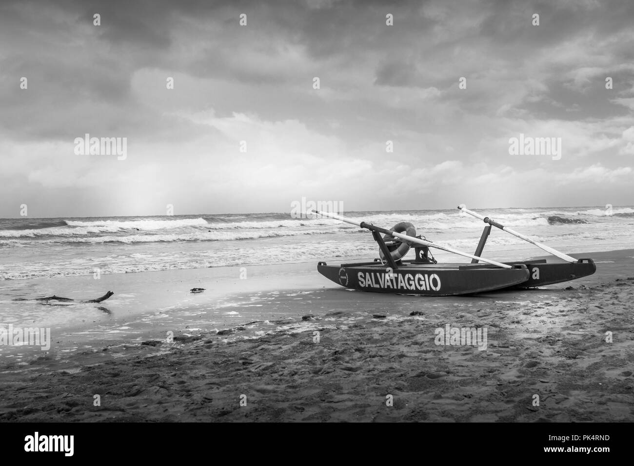 rescue boat in black and white on beach on a bad weather day Stock Photo