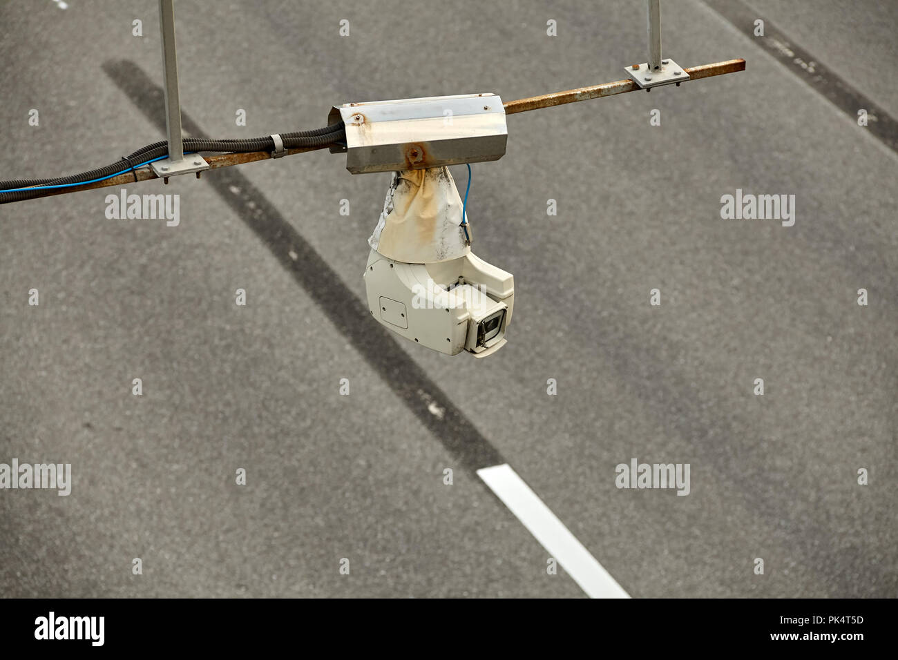 CCTV or road surveillance camera or traffic security camera is located above the highway. - Stock Image