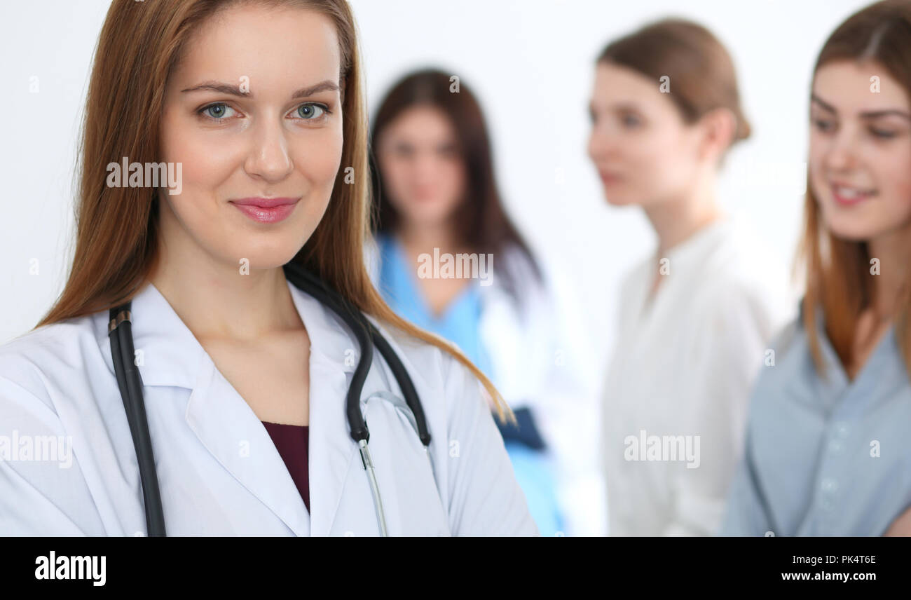 Young beautiful female doctor smiling while consulting her patient. Physician at work. Medicine and healthcare concept Stock Photo