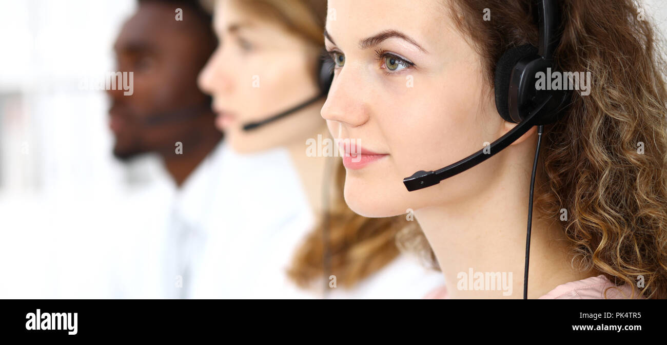 Call center operator.Young beautiful  brunette woman in headset. Business concept - Stock Image