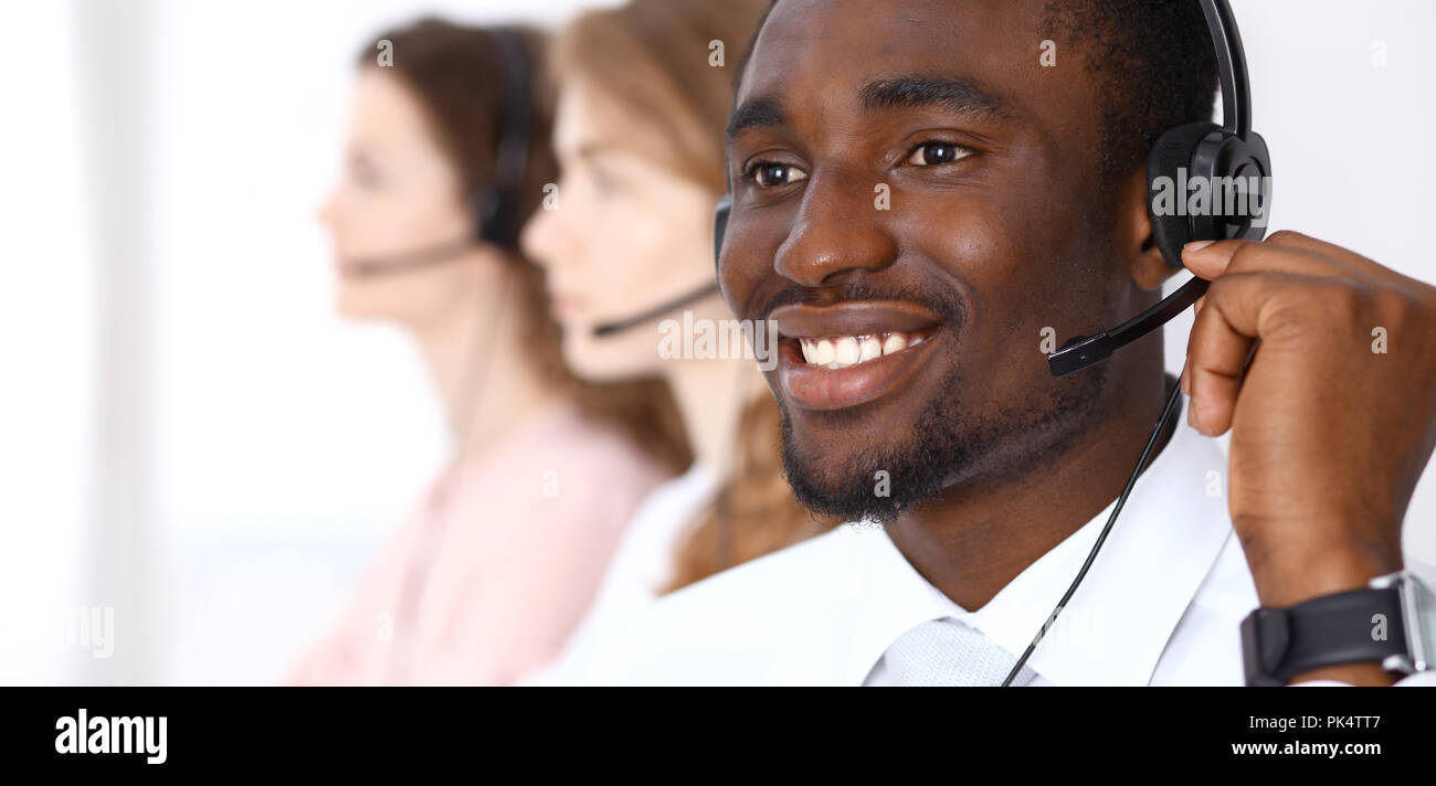 African american call operator in headset. Call center business or customer service concept - Stock Image