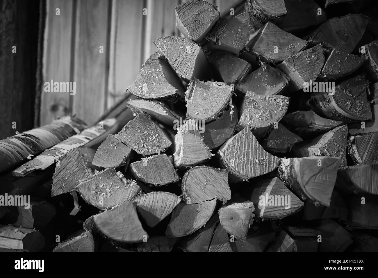 Wood burning stove. Firewood for furnace heating. Warehouse for  - Stock Image