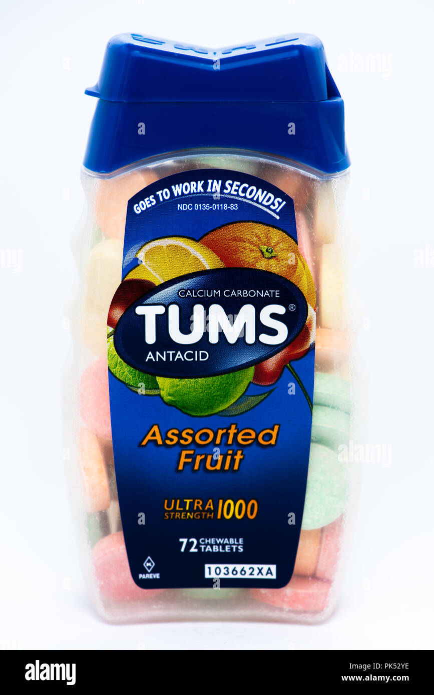 A bottle of assorted fruit flavored Tums brand antacid tablets used to provide relief from acid indigestion, heartburn and acid reflux issues. - Stock Image