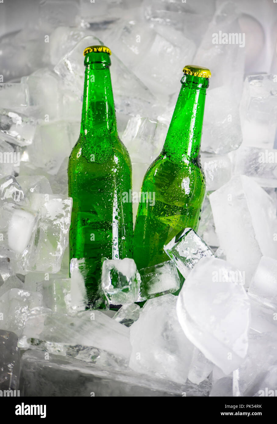 Bottles of beer on ice - Stock Image