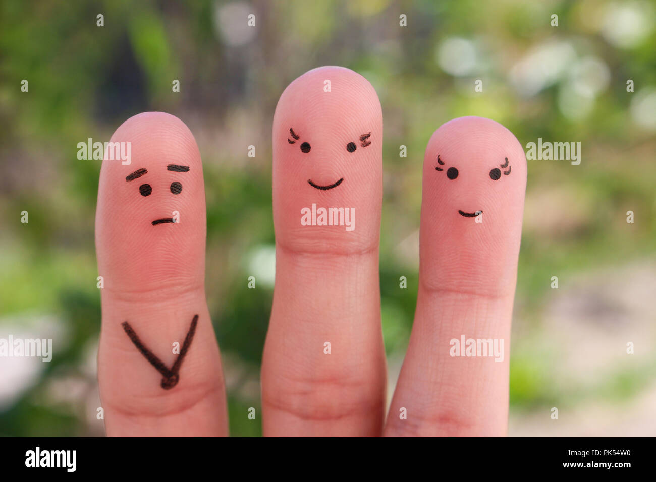 Fingers art of people. Concept a man is shy to meet women. - Stock Image