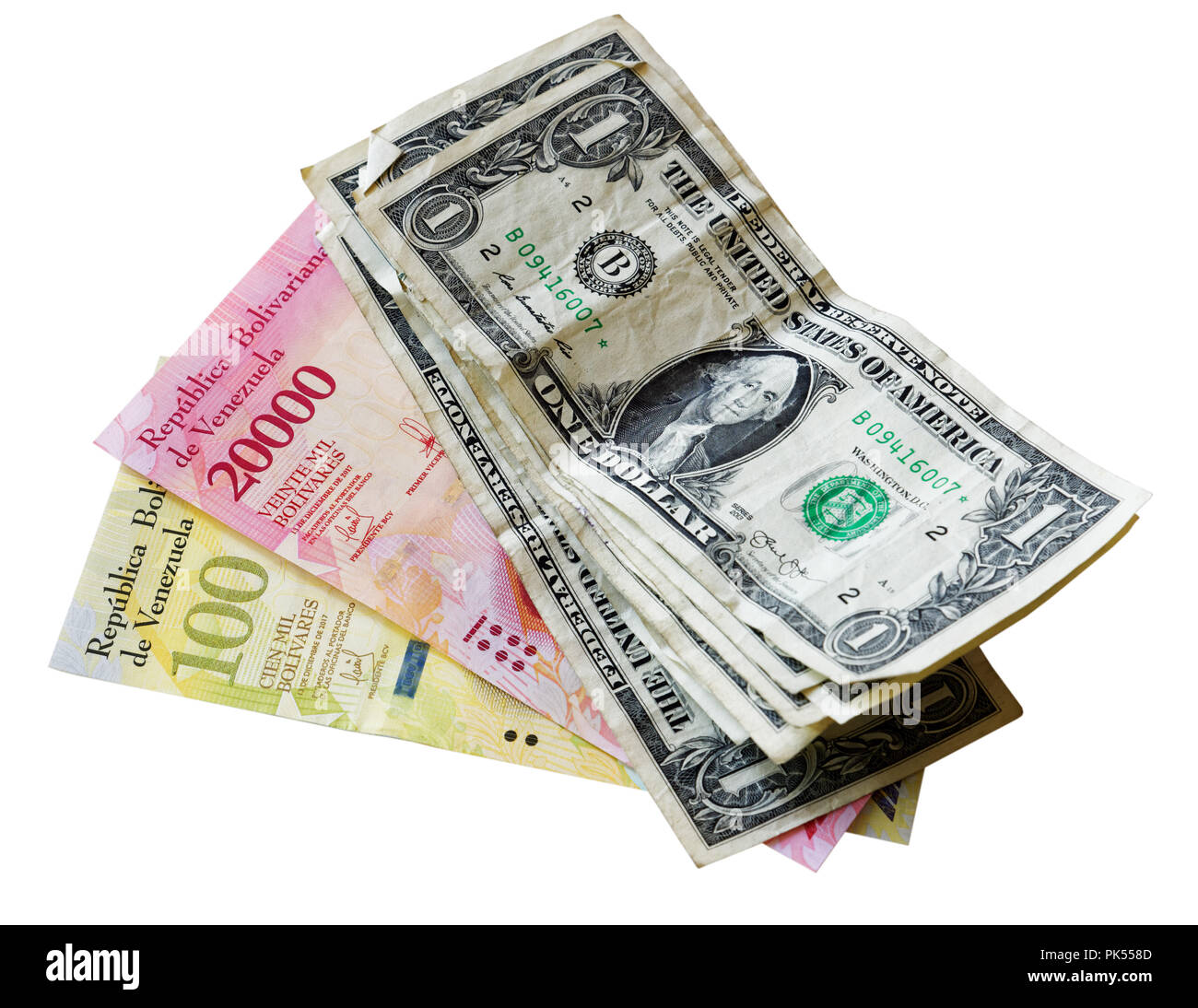 Venezuela hyperinflation Bolivar banknotes with US dollar bills - Stock Image