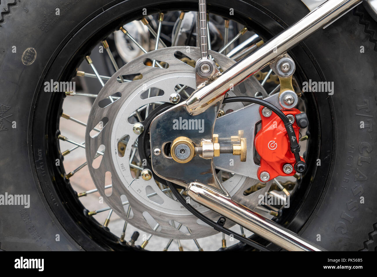 Disc brake assembly on motorcycle back wheel - Stock Image