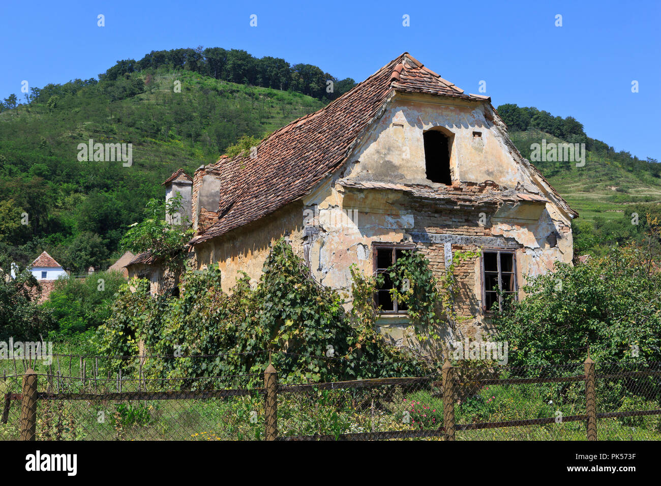 A a derelict house in Biertan, Romania - Stock Image