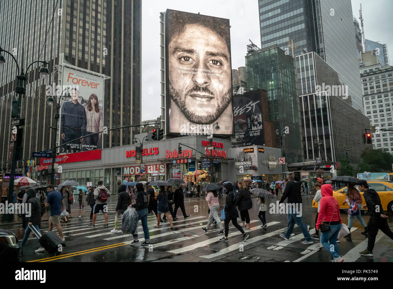 An electronic billboard for Nike products features Colin Kaepernick, the American football quarterback who in protest against police brutality 'took a knee' during the playing of the national anthem, seen on Sunday, September 9, 2018. The 'Just Do It' ad campaign, which also features other athletes, some handicapped, has elicited calls for a boycott of Nike from conservative elements as Nike saw a spike of 31% in its online sales.  (© Richard B. Levine) - Stock Image