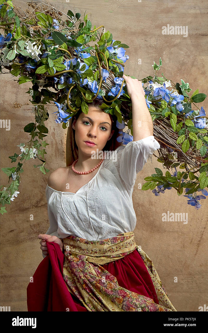 Photos recreating old world art.  Peasant girl in field with flowers, retro woman holding roses,  praying woman and more. - Stock Image