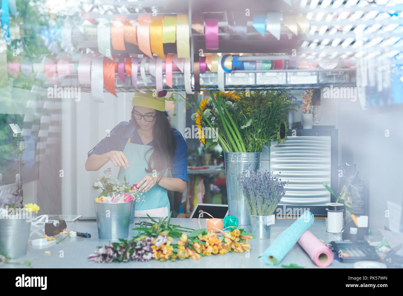 Contemporary Florist in Shop - Stock Image