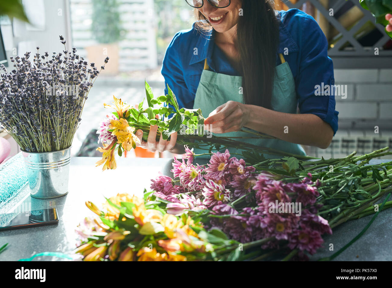 Creative Florist Arranging Bouquets - Stock Image