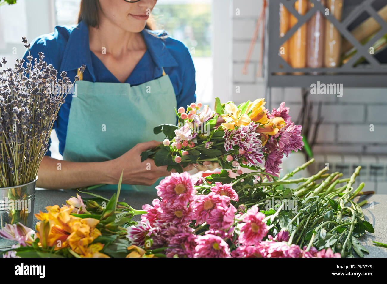 Florist Arranging Beautiful Flowers - Stock Image