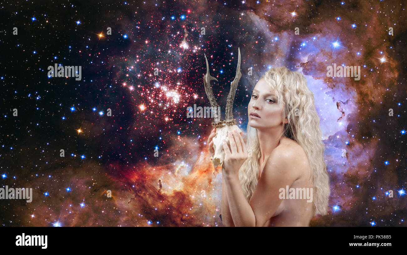Beautiful woman with horns. Capricorn Zodiac Sign on on night sky background - Stock Image