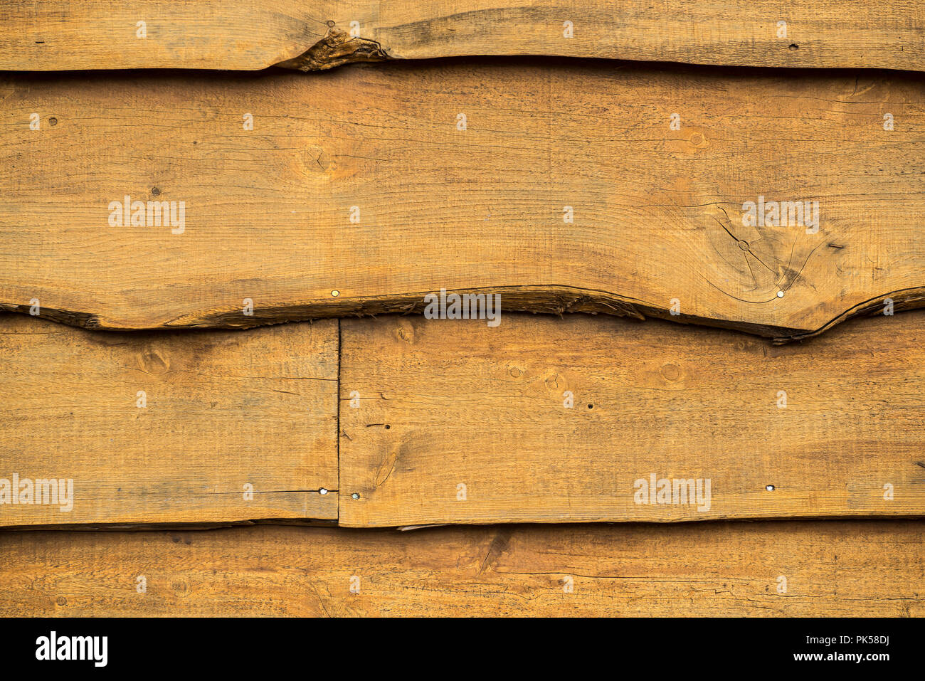 weathered barn wood siding rustic background texture - Stock Image