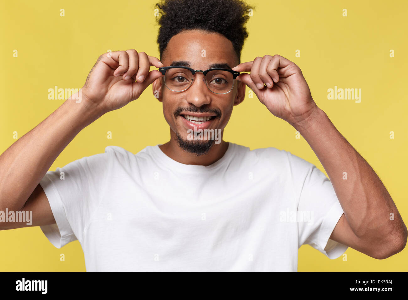 72753b3e2f6f Headshot of good-looking positive young dark-skinned male with stubble and  trendy haircut