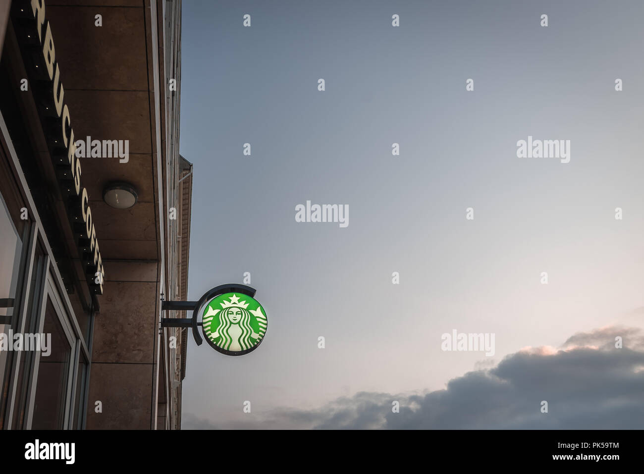 Starbucks coffeehouse with the green logo against a blue sky with text space, Copenhagen, September 6, 2018 - Stock Image