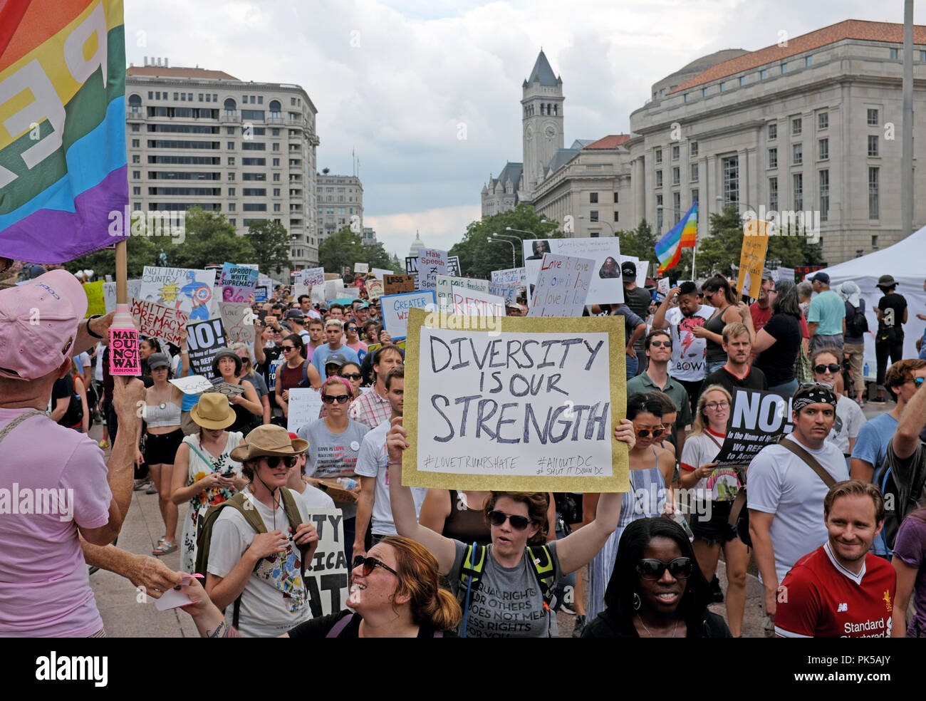 Woman holds up 'Diversity is Our Strength' sign at a rally in Washington D.C. Freedom Park as they take to the streets to protest racism and hate. - Stock Image