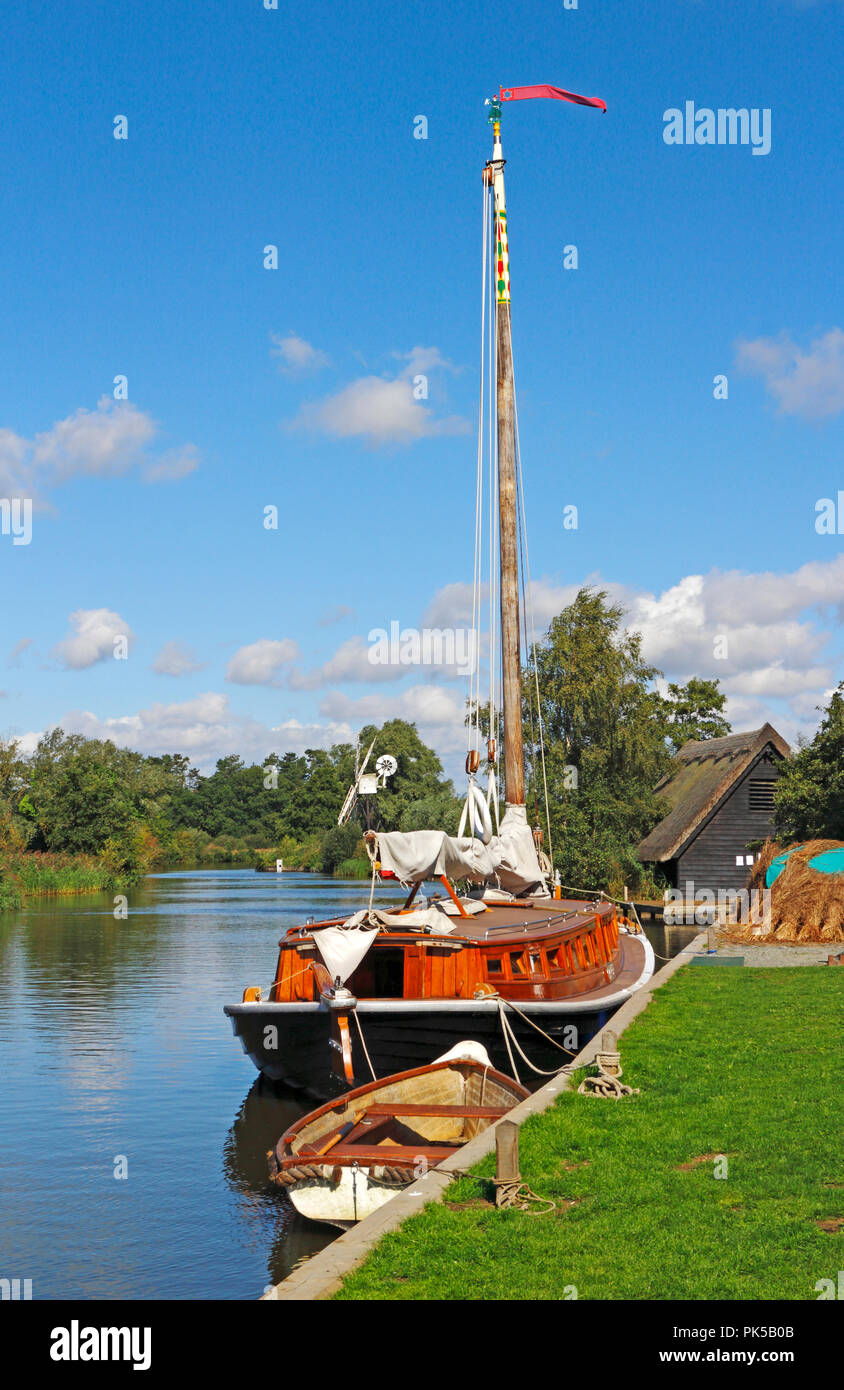 A view of the Norfolk Pleasure Wherry Hathor moored on the River Ant by How Hill, Ludham, Norfolk, England, United Kingdom, Europe. Stock Photo