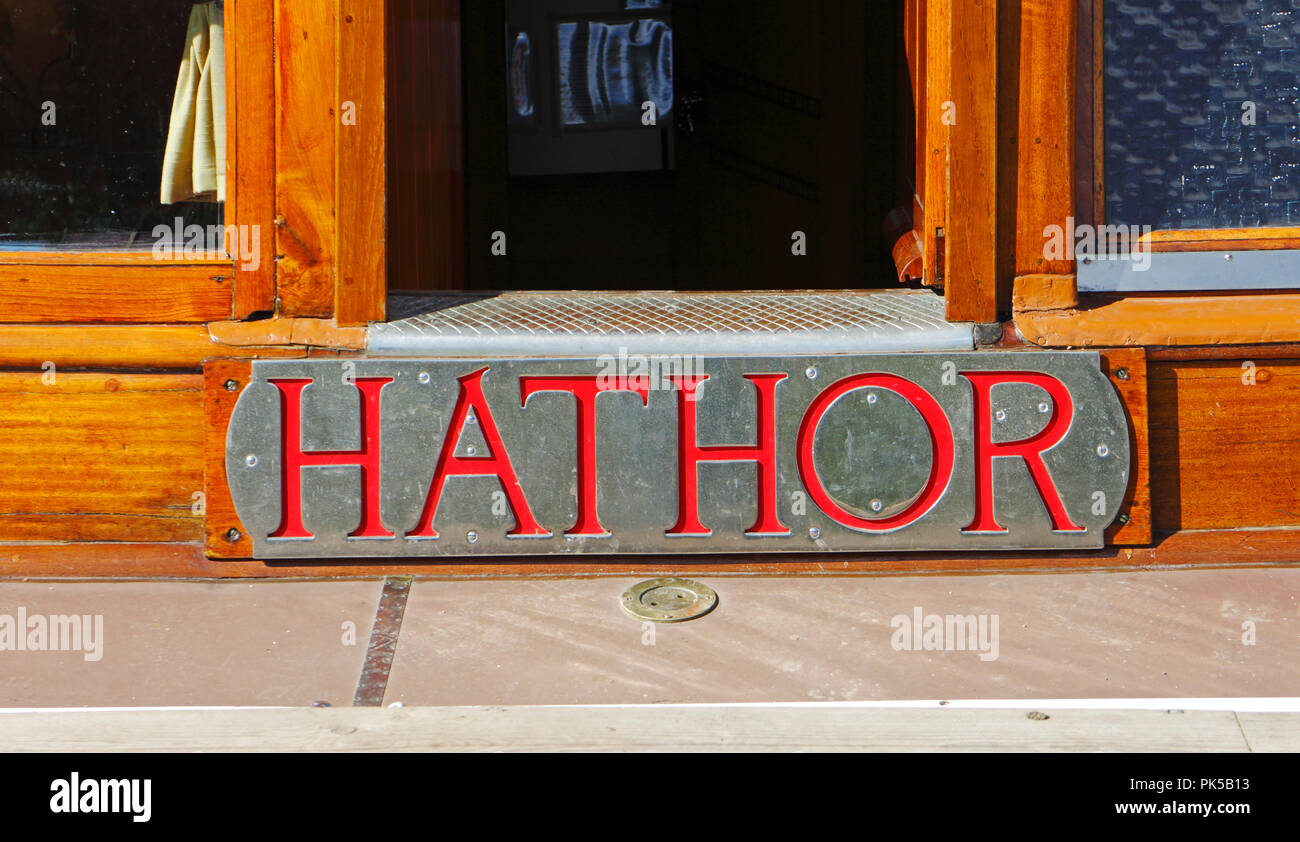 A view of the nameplate of the Norfolk Pleasure Wherry Hathor moored on the River Ant by How Hill, Norfolk, England, United Kingdom, Europe. Stock Photo