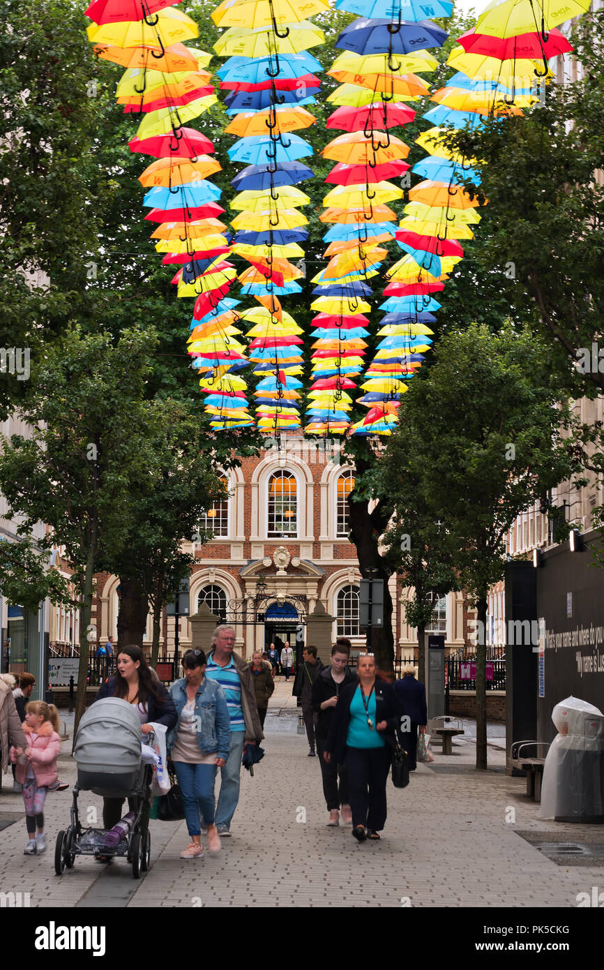 Two hundred colourful umbrellas in Church Alley Liverpool to raise awareness of ADHD, with the Bluecoat building in the background. - Stock Image