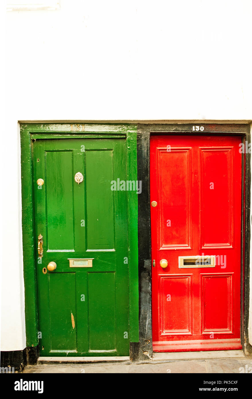 Nos 130 and 131 Red and Green painted front doors - Stock Image