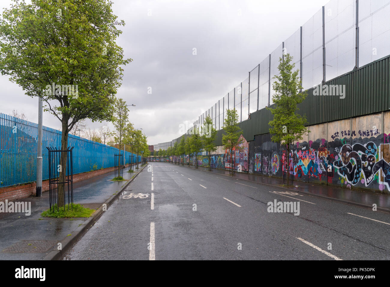 The Peace wall in West Belfast, Northern Ireland - Stock Image