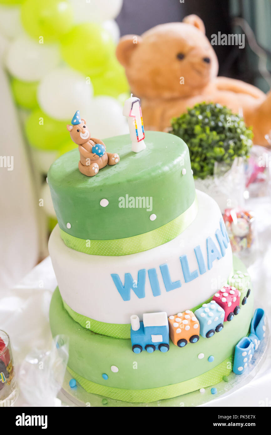Green And White Birthday Cake With One Year Old Candle Teddy Bear