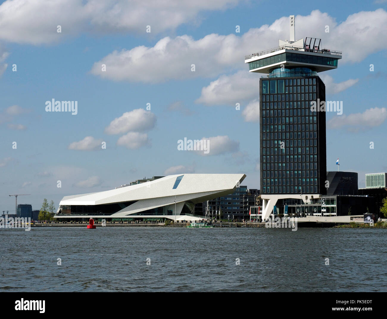 EYE Film Institute Netherlands, a Dutch archive and museum in Amsterdam is housed in this spectacular modern building. Port control tower is next door. Stock Photo