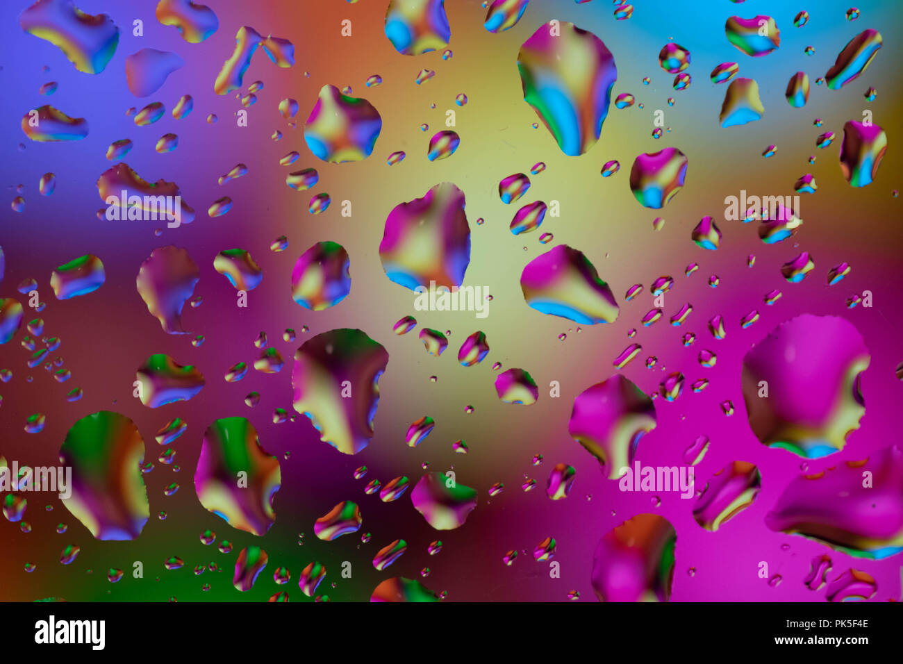 a lot of colorfull drops on window - Stock Image