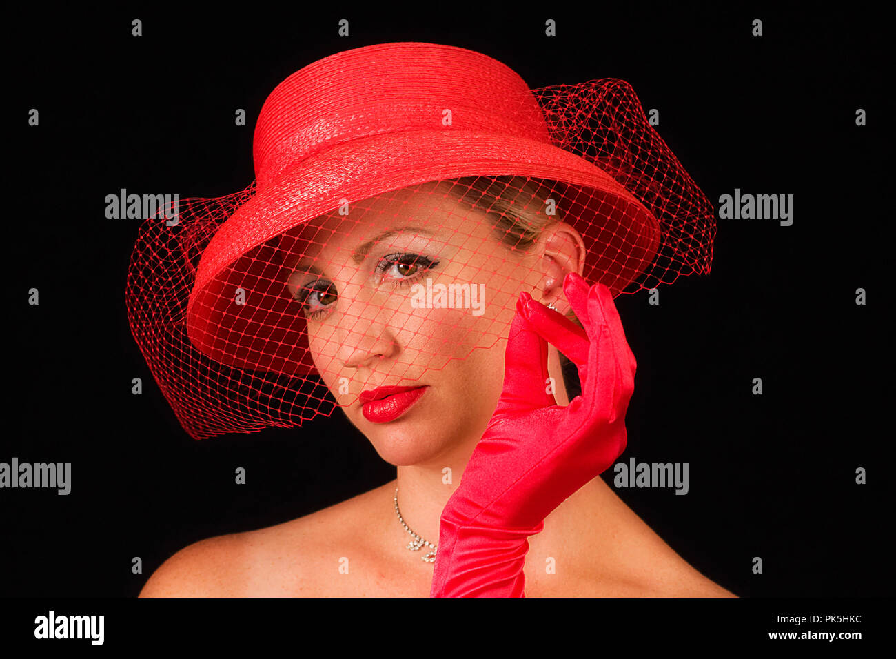 Lady wearing red retro hat with small veil and hat alone in one image. Both  isolated on black background. bf00f00a19b9