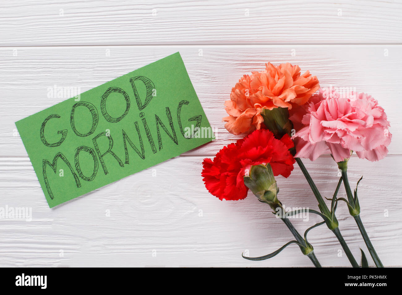 Good Morning Wish Note And Colorful Carnation Flowers White Wood