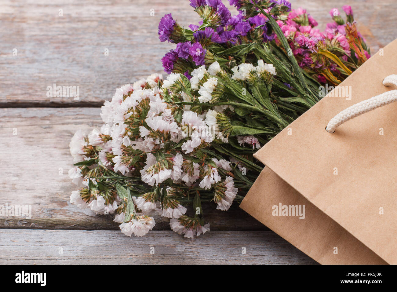 White Purple Pink Statice Limonium Flowers In Paper Bag Close Up