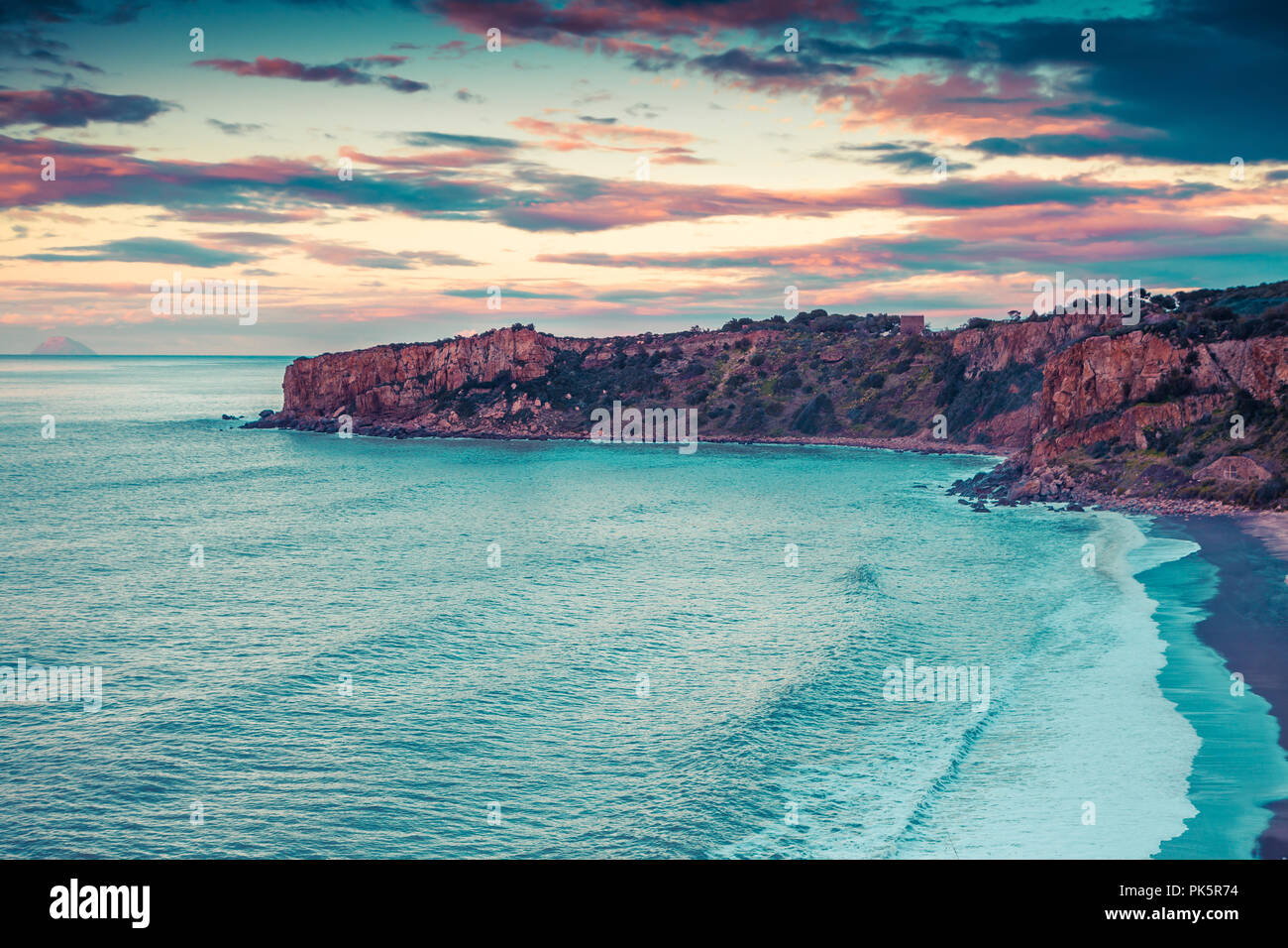 Dramatic spring sunset on the beach Torre Conca. View of Rais Gerbi cape,  Mediterranean sea, Sicily, Italy, Europe. Instagram toning. - Stock Image