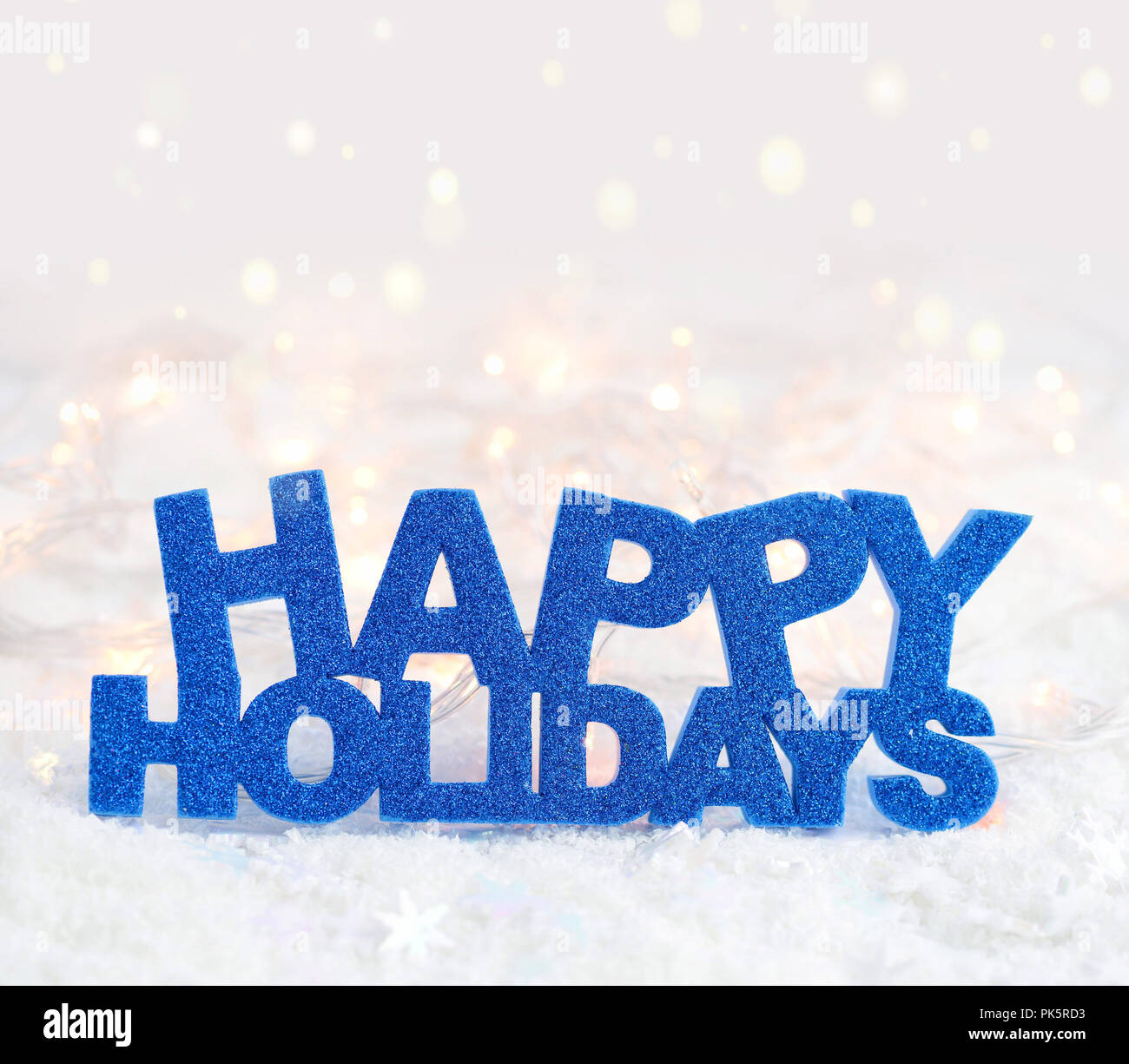 Greeting Happy Holidays Is On Snow On A Festive Background Stock