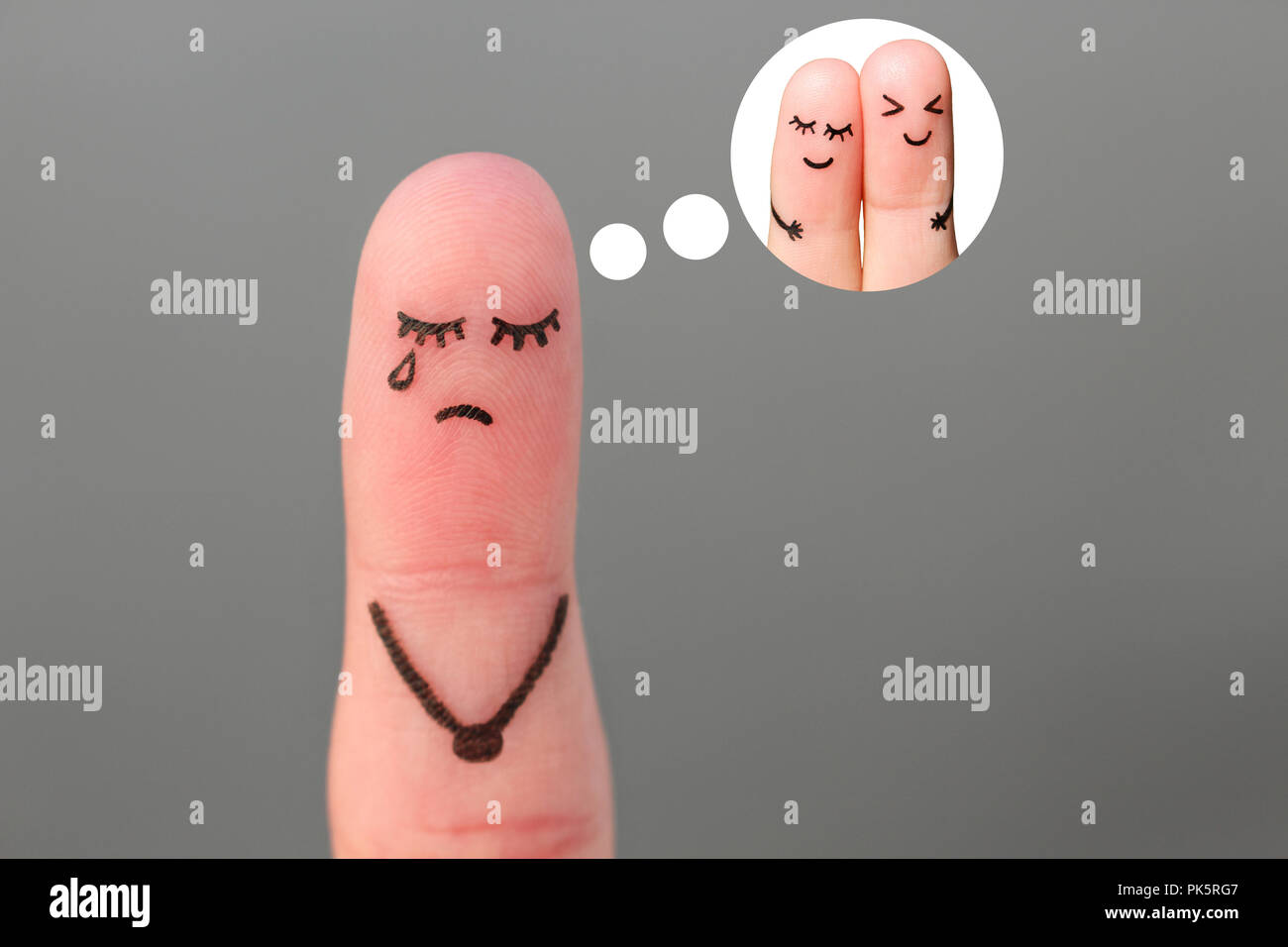 Finger art of lonely woman is crying. Concept of single girl remembers past relationship. - Stock Image