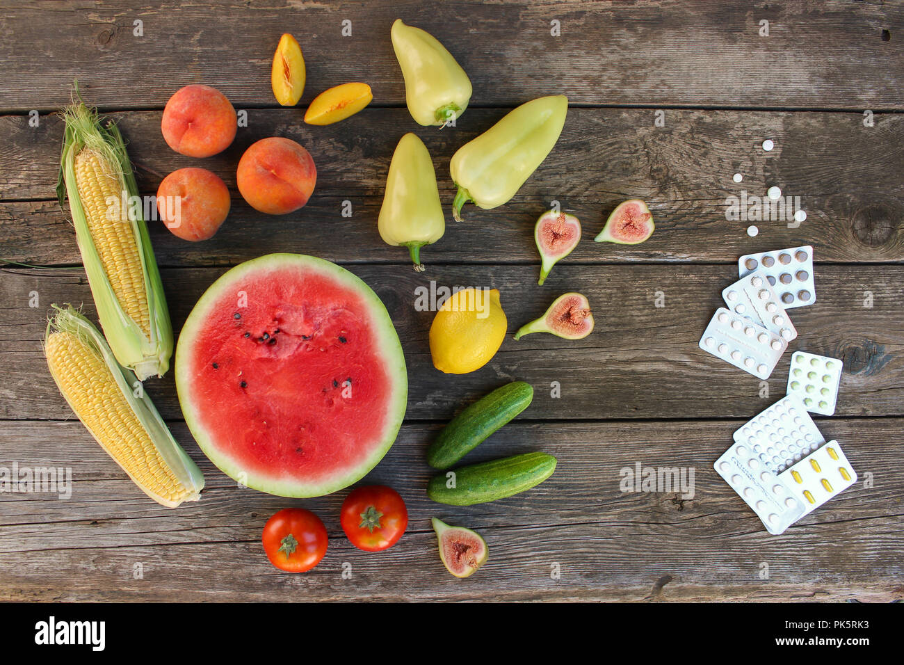 Fruits Vegetables Pills On Wooden Background Concept Of