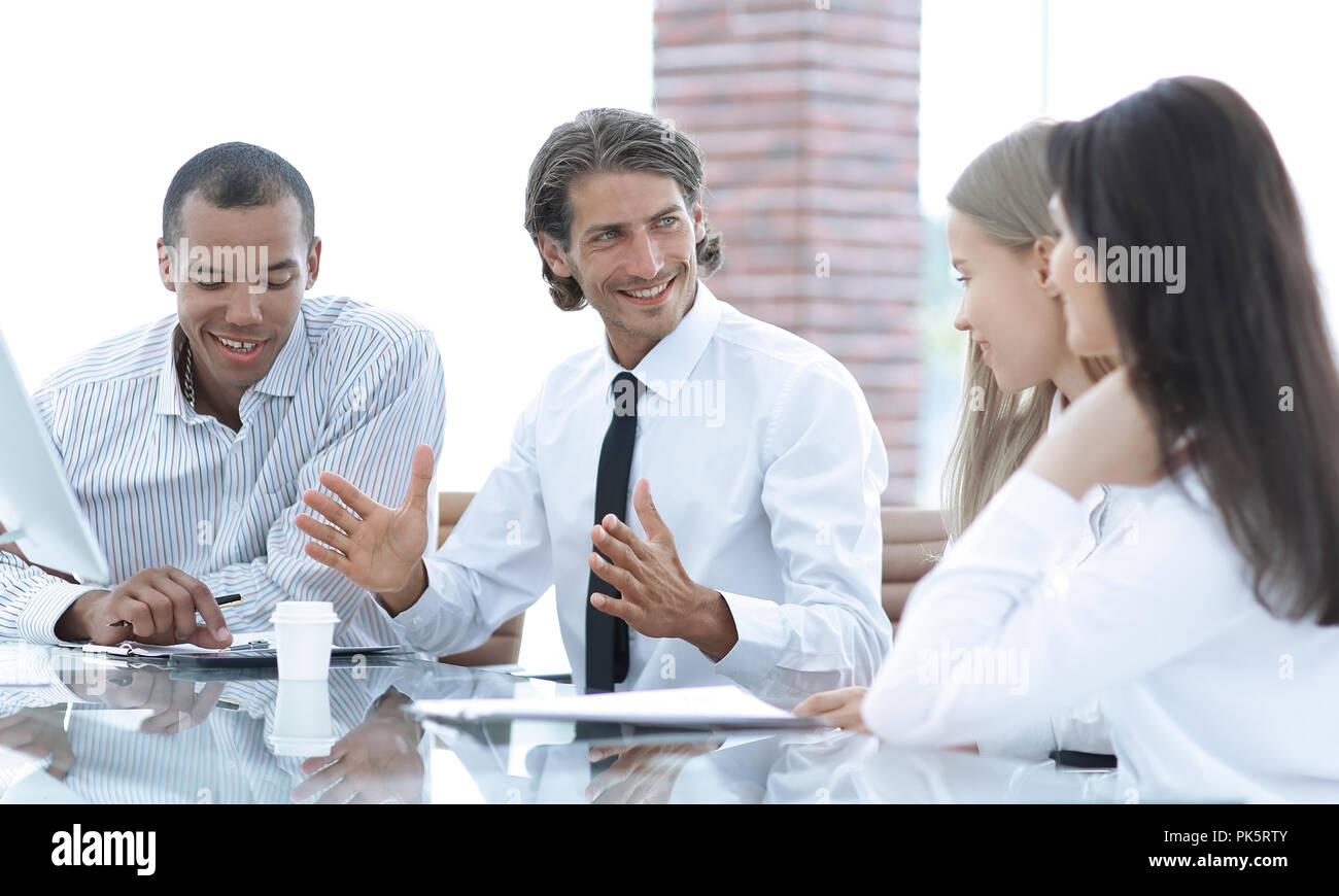 Manager holds a meeting with the business team - Stock Image